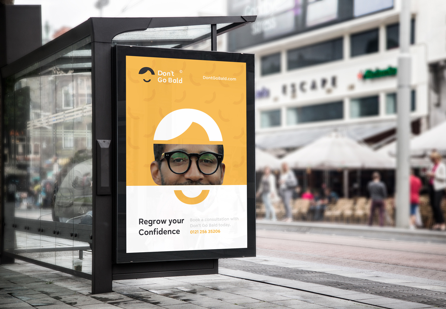 Branding and identity showcased on a bus stop bill board